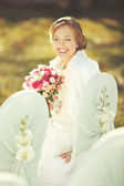 Happy bride with bouquet — Stock Photo