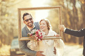 Groom and bride in frame — Stock Photo