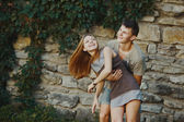 Teen couple bonding, posing together, looking at camera. — Stock Photo