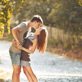 Happy teen couple embracing at street. Great relationships. — Stock Photo