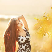 Portrait of long hair gorgeous woman in summer garden. — Stock Photo