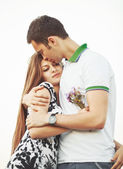 Young couple embracing. — Stock Photo