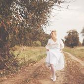 Gorgeous caucasian bride in beautiful dress — Stock Photo
