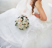 Gorgeous caucasian bride in beautiful dress — Stock Photo