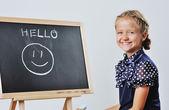 Smiling cute school girl drawing  — Stock Photo