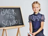 Smiling cute school girl drawing  — Foto Stock