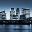 Canary Wharf at twilight - Stock Photo