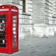 Telephone box in London - Stock Photo