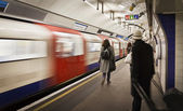 Cathcing the tube — Stockfoto