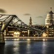 Millennium bridge and St. Paul's cathedral — Stock Photo