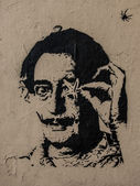 Salvador Dali graffiti portrait with starfish and spider — Stock Photo