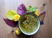 Tea cup with tea inscription in autumnal setting. Closup. — Stock Photo