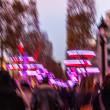 Avenue des Champs elysees (Paris) with Christmas festive illumination and shopping crowd. Abstract blur of a city street scene at night. Back view. — Stock Photo #16358345