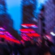 Avenue des Champs-elysees (Paris) with Christmas festive illumination and shopping crowd. Abstract blur of a city street scene at night. Back view. - Stock Photo