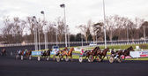 PARIS - DECEMBER 16: Trotters race in Paris Vincennes hippodrome as seen on December 16, 2012 in Paris, France. Vincennes racetrack was opened at 1863. — Stock Photo