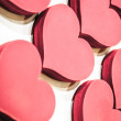 Pink wooden hearts. Valentine background. — Stock fotografie