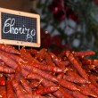Traditional chorizo sausage at Christmas market. Paris. — Stockfoto #18568683