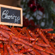Traditional chorizo sausage at Christmas market. Paris. — Stock Photo