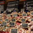Sausage on a market stand. Christmas market in Paris. — Stock Photo #18568817