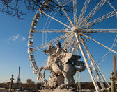 Horseman statue. Ferris wheel and Eiffel tower at background. Paris. — Stock Photo