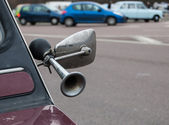 Closeup of klaxon attached to side mirror of vintage car. — Stock Photo