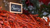 Traditional chorizo sausage at Christmas market. Paris. — Stock Photo