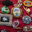 Jewelry background. Vintage brooches at flea market in Paris. - Stock Photo