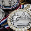 Stock Photo: Unique vintage sport medals at flea market in Paris. Billiards, swimming and ski medals.