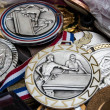 Unique vintage sport medals at flea market in Paris. Billiards, swimming and ski medals. — Stock Photo