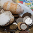 Old coins, two, shells, russian bank note on colorful plate at flea market in Paris. — Stock Photo