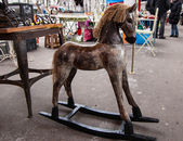 Vintage rocking horse at flea market in Paris. — Stock Photo