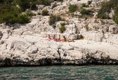 Six young women sunbathe in famous Calanques national park — Stock Photo