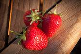 Three fresh strawberries — Stock Photo