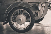 Detail of front wheel of vintage car — Stock Photo