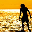Silhouette of fishing young — Stock Photo