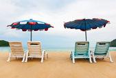 Beach chairs on perfect tropical white sand beach — Stock Photo