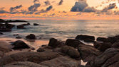 Sea wave on the rock at sunset — Stock Photo