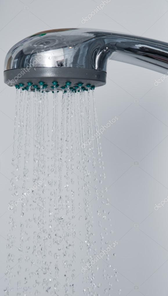 Water pours out of the shower in the bathroom  Stock Photo #12692589