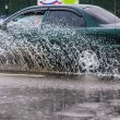 Stock Photo: Spray from car