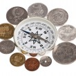 Coins around the compass — Stock Photo #12728953