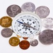 Coins around the compass — Stock Photo #12728958