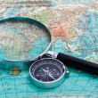 Compass and magnifying glass — Stok fotoğraf