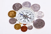 Coins around the compass — Stock Photo
