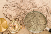 Compass with map — Stockfoto