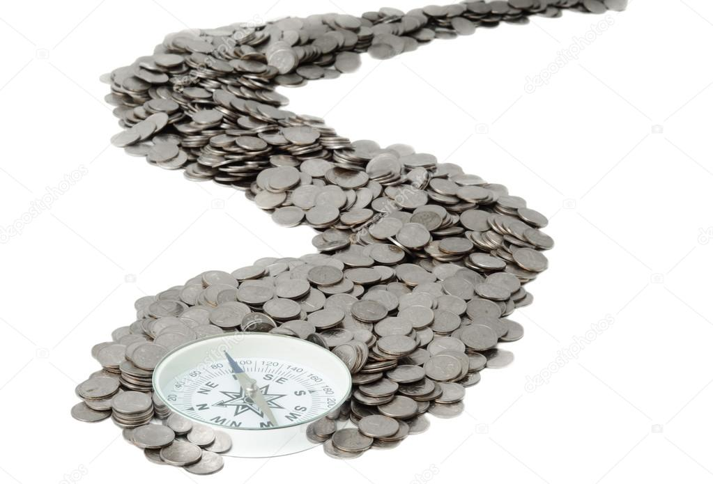 Compass is at the beginning of the road from coins — Stock Photo #12728915