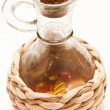 Wicker bottle with oil — Stockfoto