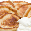 Fritters with sour cream - Stock Photo