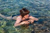 Woman in the sea — Stock Photo