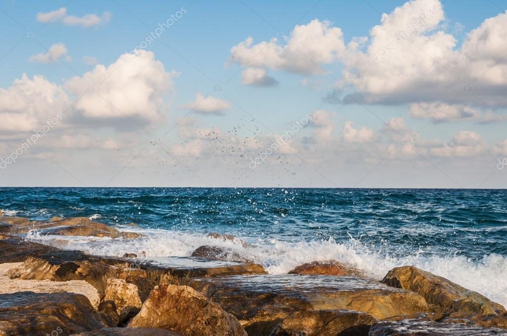 Waves on the sea landscape on a background of blue sky with clouds  Stock Photo #13848612
