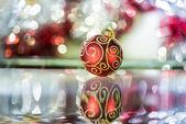 Christmas ball and tinsel — Stock Photo